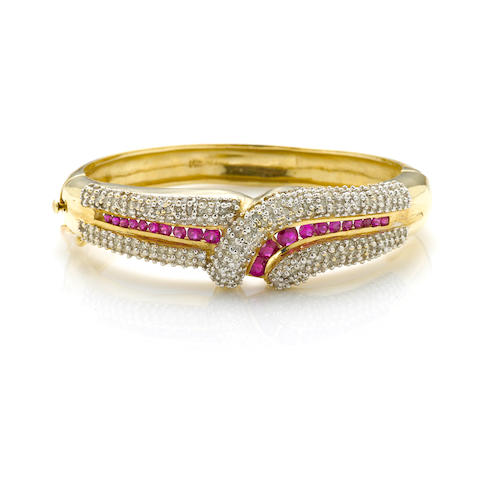 "A diamond, ruby and 14k bicolor gold ""crossover"" bangle bracelet"
