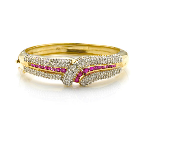 "A diamond, ruby and 4k gold ""crossover"" bangle"