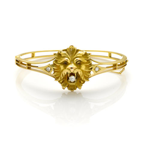"A 14k gold ""Lionshead"" bangle with a diamond in the mouth"