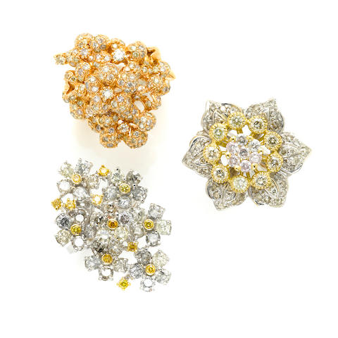 A group of three diamond and gold cluster rings