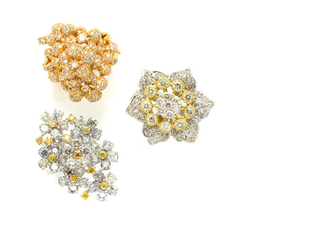 A group of three diamond and gold cluster rings (2 are 18k)