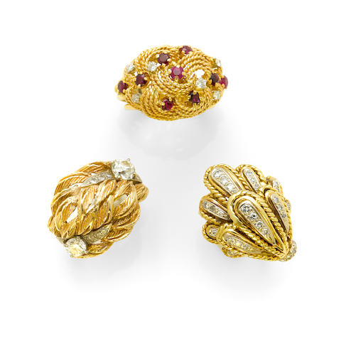 A collection of three gem-set, diamond and bicolor gold rings