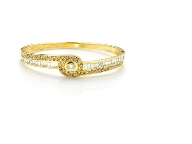 A diamond and 14k gold bangle bracelet