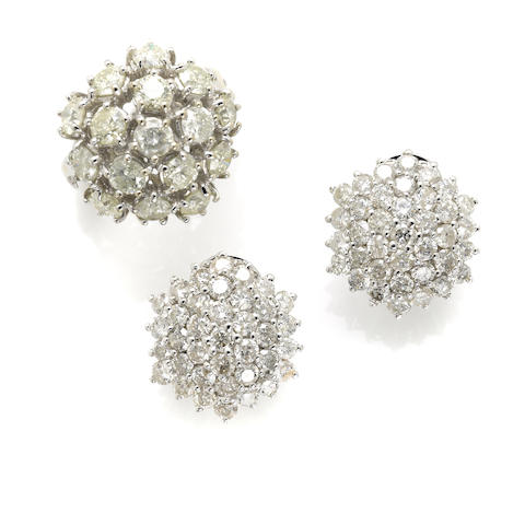 A pair of diamond cluster earrings and ring