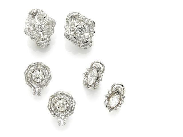 A collection of diamond and white gold earrings