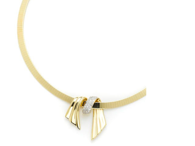 A diamond and gold slider pendant and gold necklace