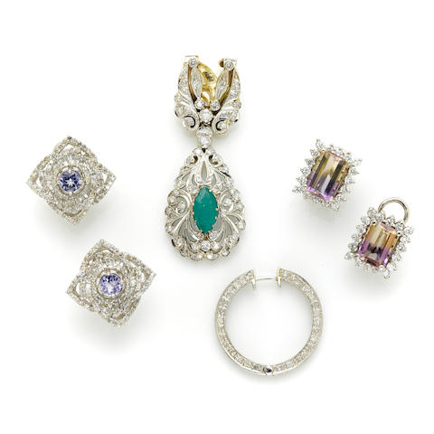 A group of diamond and white gold jewelery
