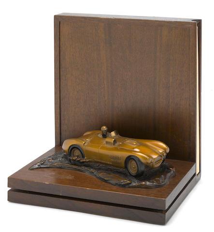 Cunningham book plinth bronze by larry braum,
