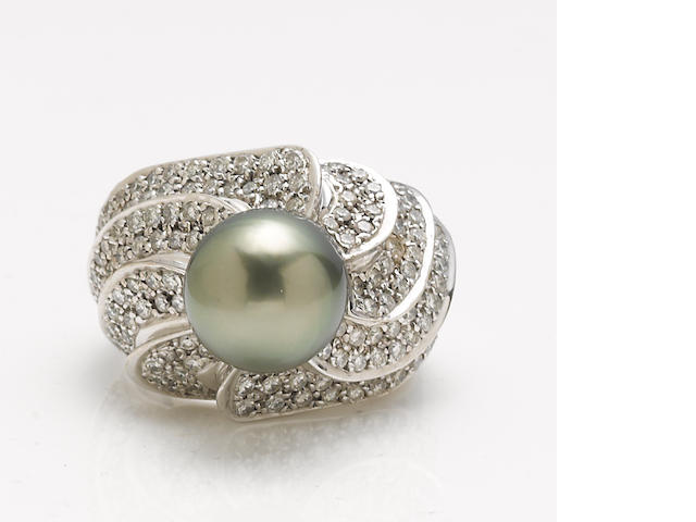 A black cultured pearl, diamond and 14k white gold ring