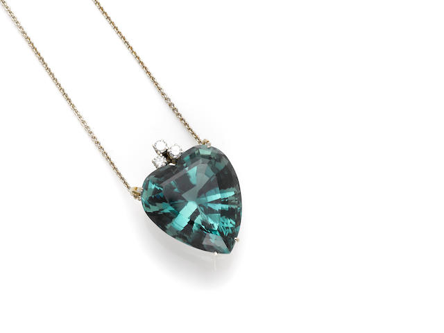 A green tourmaline, diamond and white gold heart shaped pendant and chain