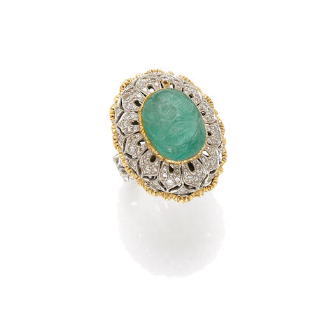 A carved emerald, diamond and bicolor gold ring