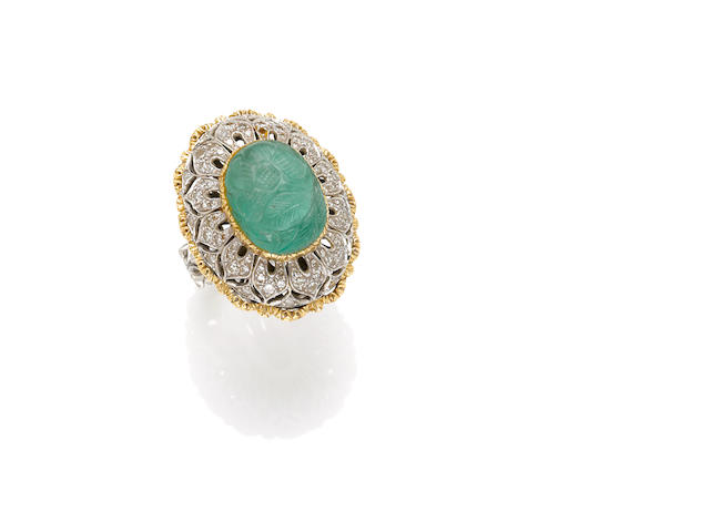 A carved emerald, diamond and gold ring
