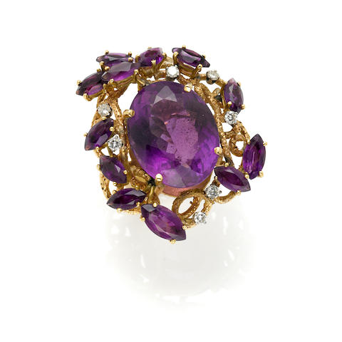 An amethyst, diamond and 14k gold cluster ring