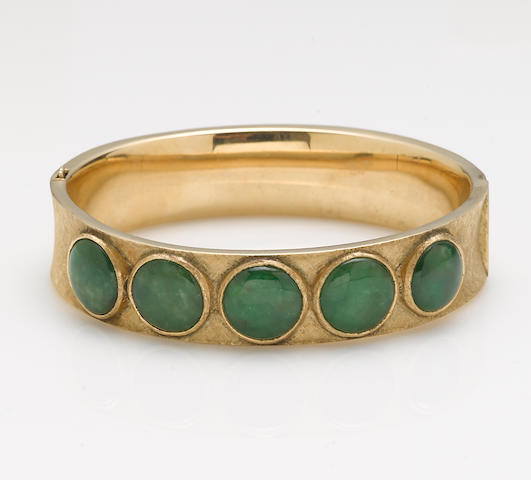 A jadeite jade and 14k gold bangle bracelet