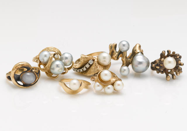 A collection of seven cultured pearl, diamond, white star sapphire 10k and 14k gold rings