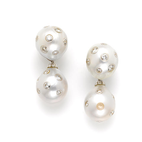 A pair of cultured pearl, diamond and white gold day-night earrings