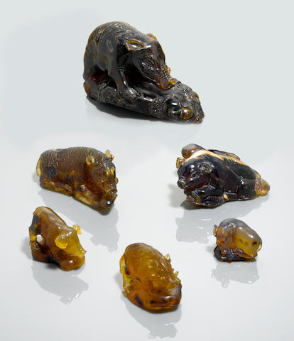 Set of Six Carved Amber Pigs