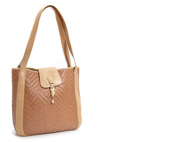 A Kieselstein-Cord tan leather handbag, with frog pendant detail