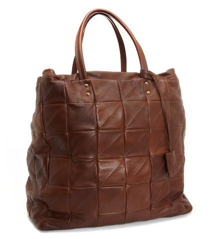 A large Yves Saint Laurent brown leather tote bag