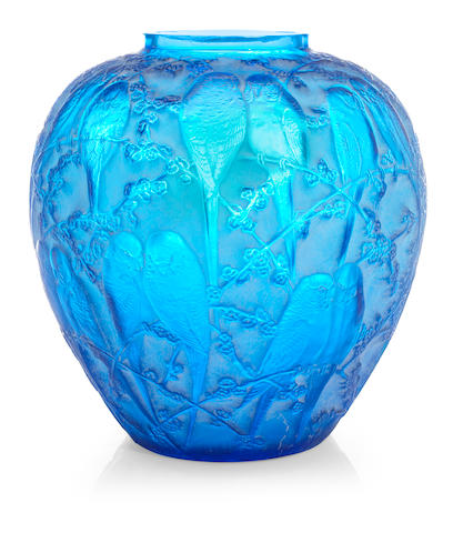A Rene Lalique molded blue glass vase: Perruches