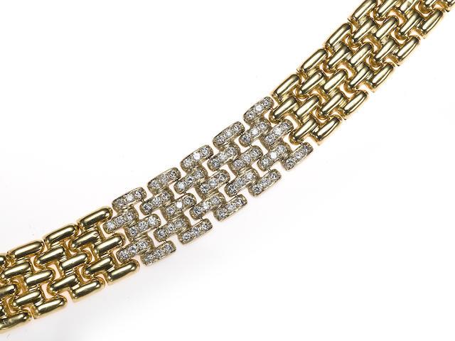 A diamond and 14k gold brick link bracelet