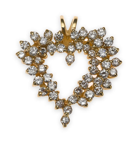 A diamond and 14k gold heart pendant