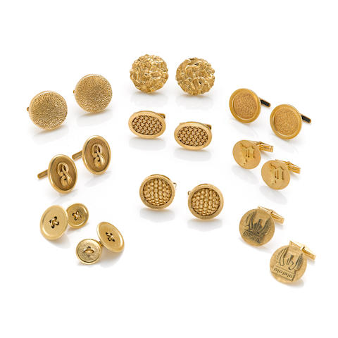 A collection of nine pairs of 14k yellow gold cuff links