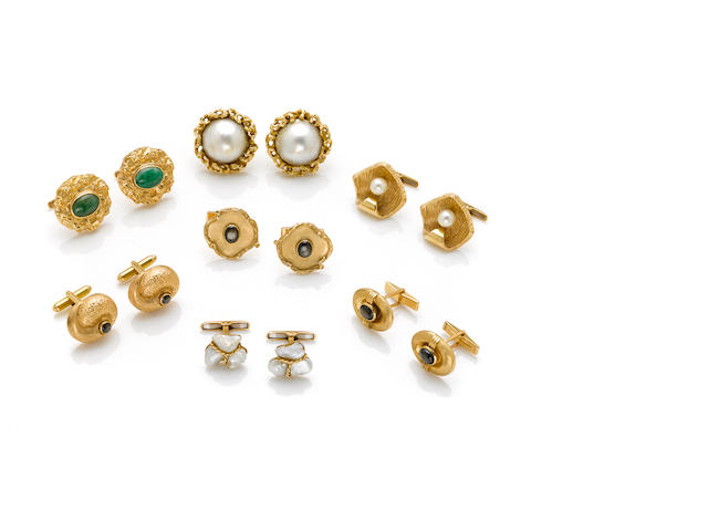 A collection of seven pairs of 14k yellow gold and gem-set cuff links