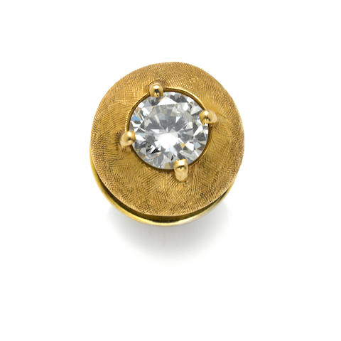 A diamond and gold tie tack
