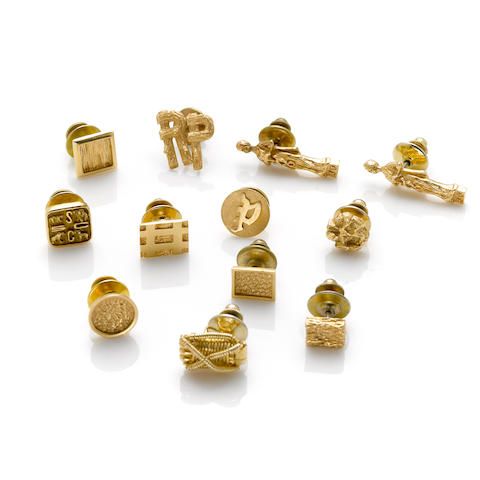 A collection of twelve gold tie tacks