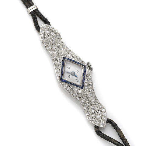 An art deco diamond, sapphire and platinum strap wristwatch