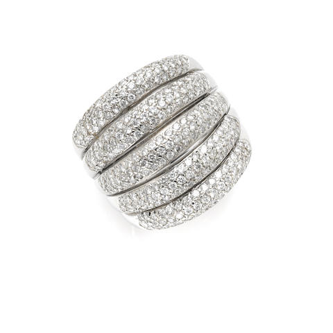 A round brilliant cut diamond and 18 karat white gold five row band