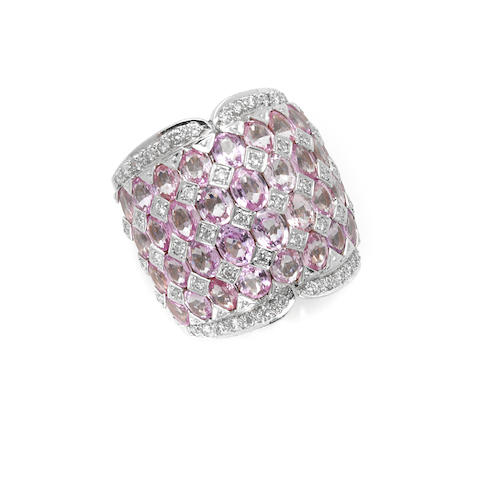 A pink sapphire, round brilliant cut diamond and 18 karat white gold band