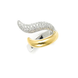 A pave, round brilliant cut diamond and 18 karat gold two-tone free-form ring