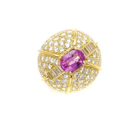 An oval, pink sapphire, round brilliant cut and baguette diamond and 18 karat gold dome ring