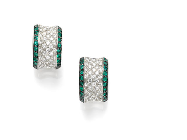 A pair of round brilliant cut diamond, emerald and 18 karat white gold earring cuffs, Drake