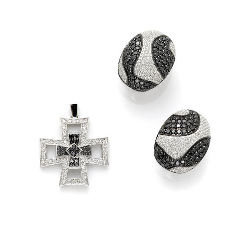 A pair of black and white diamond earrings together with a black diamond, diamond and 14 karat white gold 'cross' motif pendant