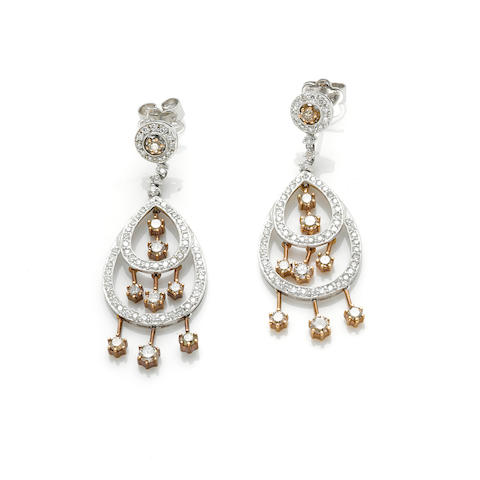 A pair of brown diamond, diamond and 18 karat gold two-tone dangle earrings