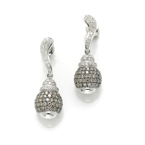 A pair of colored diamond, diamond and 14k white gold earrings