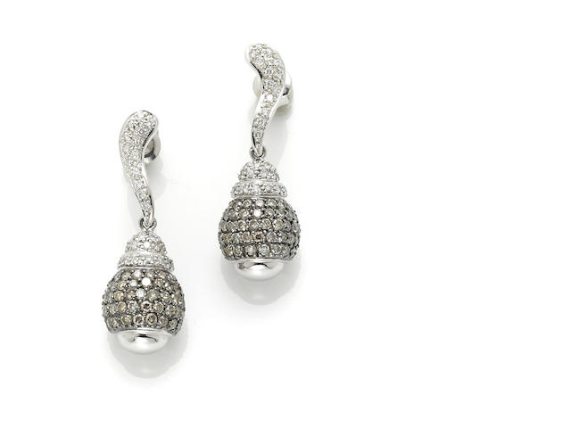 A pair of brown diamond, diamond and 14 karat white gold dangle earrings