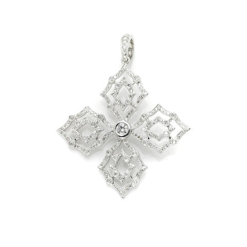 A diamond and 18k white gold pendant