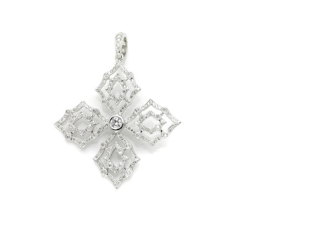A round brilliant cut diamond and white gold quatrefoil pendant