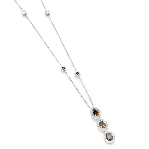 A pear shape brown diamond and platinum pendant With sapphire, round brilliant cut diamond and 18 karat white gold chain.