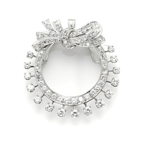 A round brilliant cut, single-cut and 14 karat white gold circle bow brooch