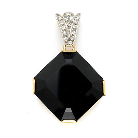 A smoky quartz, round brilliant cut diamond and gold pendant
