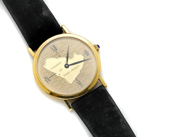 "A gold ""Kingdom of Saudi Arabia"" wristwatch with a leather strap"