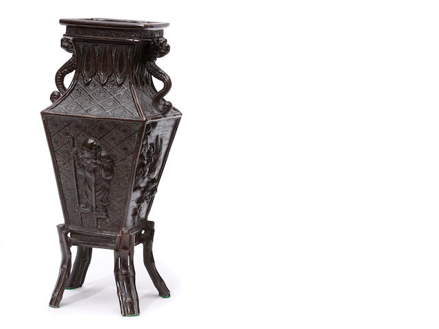 A bronze vase with stand