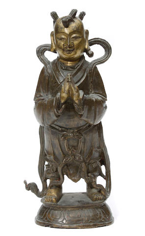 A bronze Daoist figure of a boy