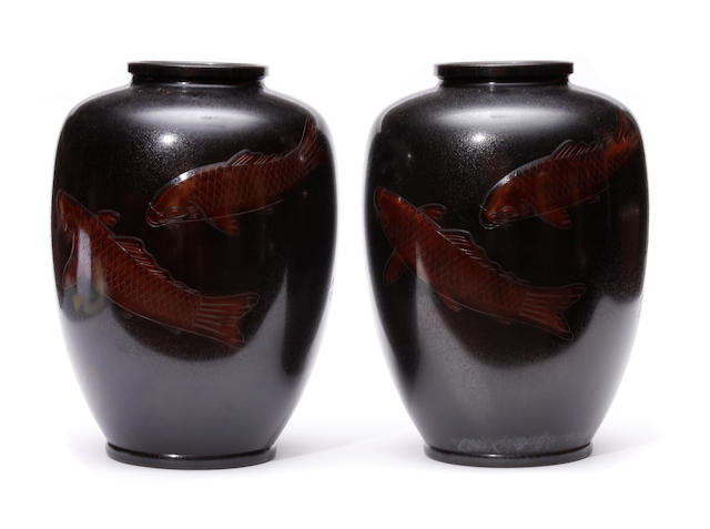 A pair of bronze vases with carp in relief