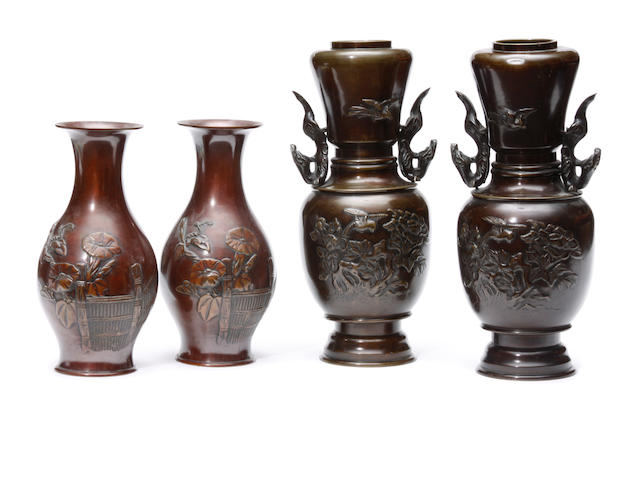A group of two pairs of Japanese bronze vases